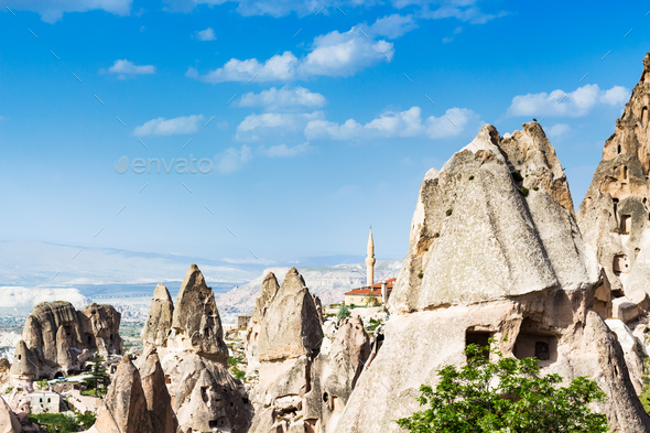 fairy chimney rocks and mosque in Uchisar town - Stock Photo - Images