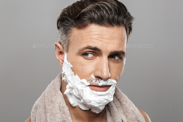 Mature man standing isolated with shaving cream on face. - Stock Photo - Images