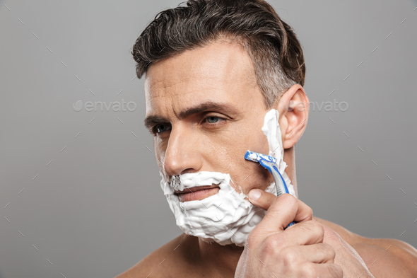 Mature man naked shaving. - Stock Photo - Images
