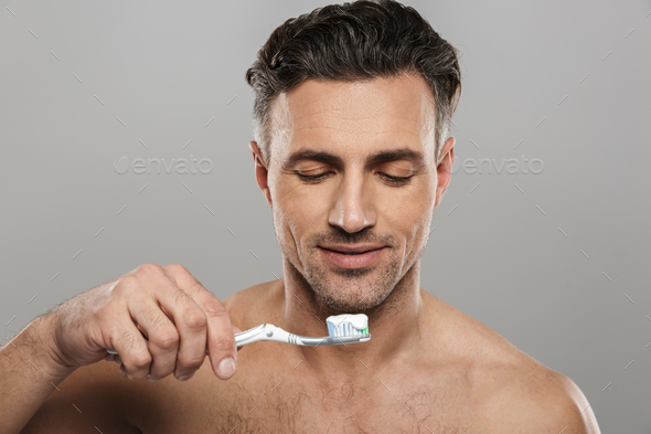 Handsome mature man brushing his teeth. - Stock Photo - Images