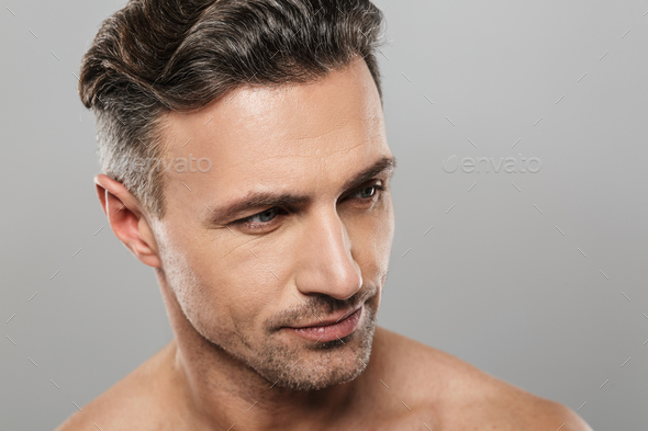 Handsome serious mature man. Looking aside. - Stock Photo - Images