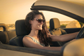 Girl driving a convertible car
