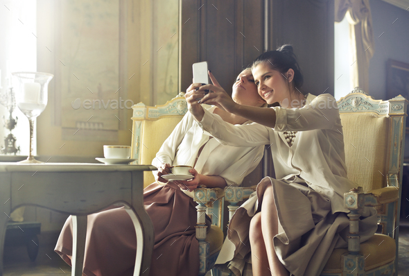 Girls taking a selfie - Stock Photo - Images