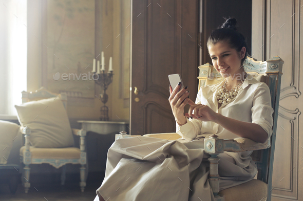 Girl using a smartphone - Stock Photo - Images