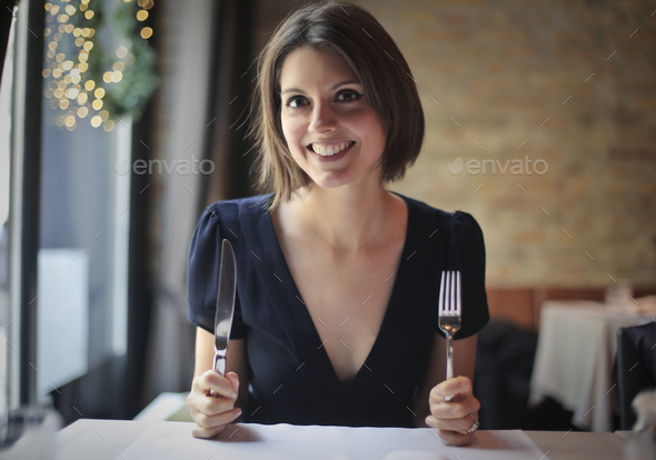 Girl ready to have lunch - Stock Photo - Images