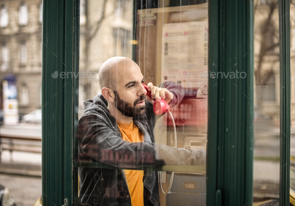 Man in a phone box - Stock Photo - Images