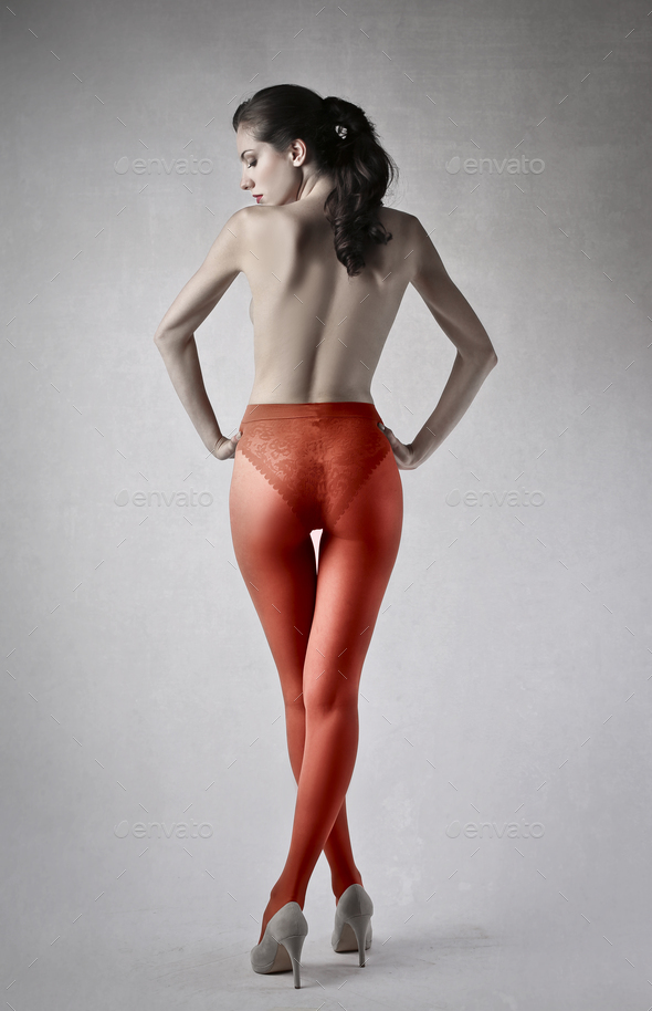 Woman wearing red tights - Stock Photo - Images