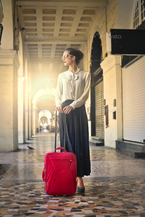 Woman with a trolley  - Stock Photo - Images