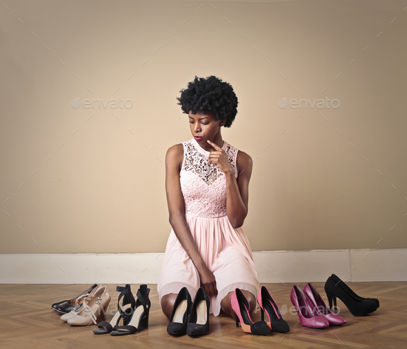 Girl choosing shoes - Stock Photo - Images