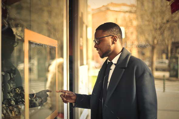 Man looking at a shop window - Stock Photo - Images