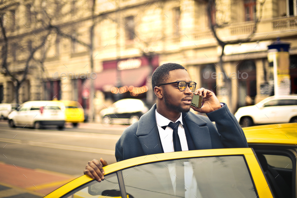 Man getting into a taxi - Stock Photo - Images