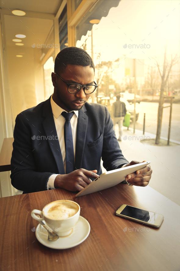 Man looking at a menu - Stock Photo - Images