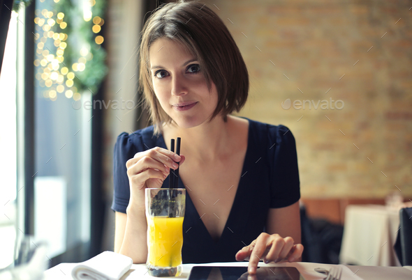 Girl drinking a juice - Stock Photo - Images