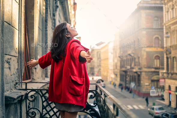 Girl on a balcony - Stock Photo - Images