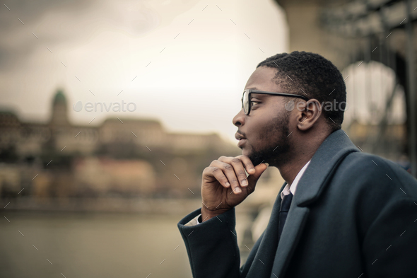 Man looking to a ladscape - Stock Photo - Images