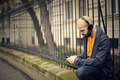 Man listening to music outdoor - PhotoDune Item for Sale