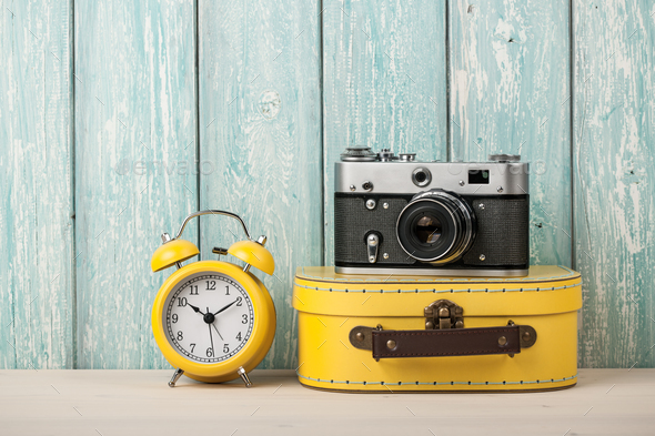 Travel concept with suitcase, film camera and alarm clock - Stock Photo - Images