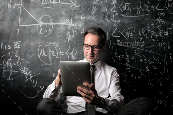 Businessman with a tablet - Stock Photo - Images