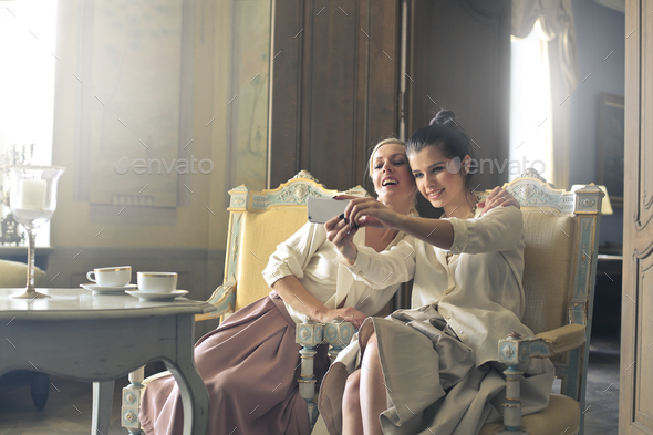 Two girls taking a selfie - Stock Photo - Images