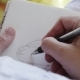 Girl Artist in Sunglasses Draws Sketches in Notebook - VideoHive Item for Sale