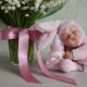 Toy with Baby Milk Sits on a Table Near Flowers. For Baby Shower. for Thematic Birthday Decor - VideoHive Item for Sale