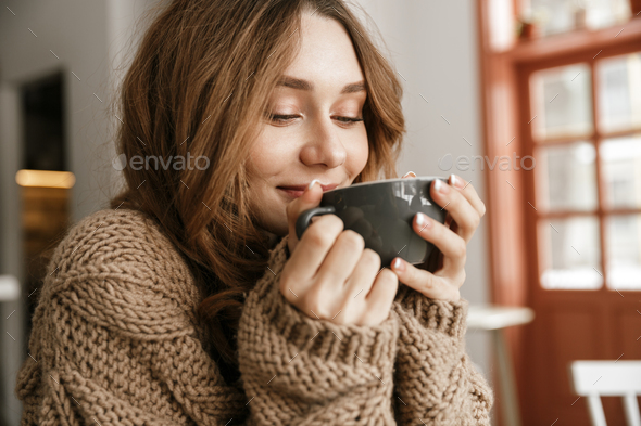 Portrait closeup of glad smiling woman in knitted sweater, sitti - Stock Photo - Images
