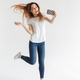 Full length image of Playful woman in casual clothes making selfie - PhotoDune Item for Sale