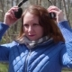 A Young Girl in the Park Listening to Music in Headphones - VideoHive Item for Sale