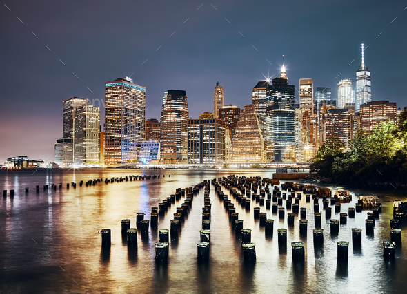 Manhattan skyline seen from Brooklyn at night, NYC. - Stock Photo - Images