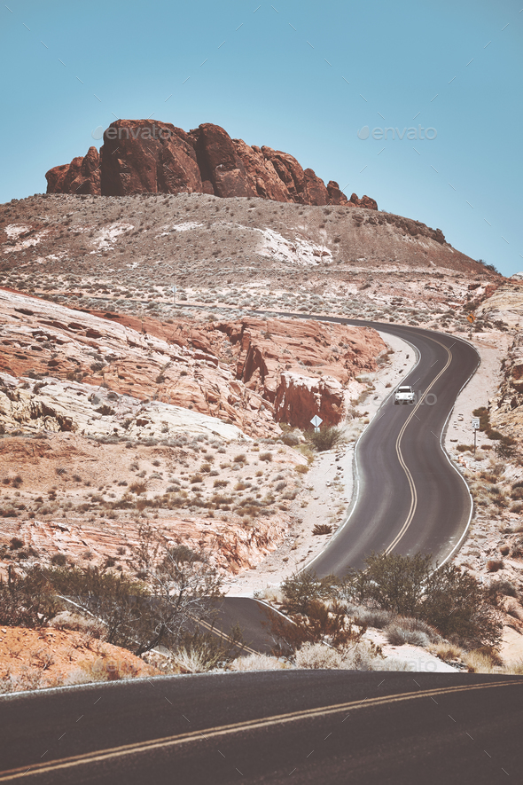 Retro toned picture of a scenic winding road. - Stock Photo - Images