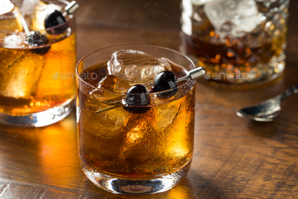 Boozy Manhattan Cocktail on the Rocks - Stock Photo - Images