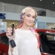 Muslim Woman with Car Key over Car Show Background - VideoHive Item for Sale