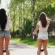 Two Girlfriends Riding on White Segways Launch Soap Bubbles - VideoHive Item for Sale