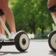 Girl in Shorts Stands on White Self-balancing Scooter - VideoHive Item for Sale