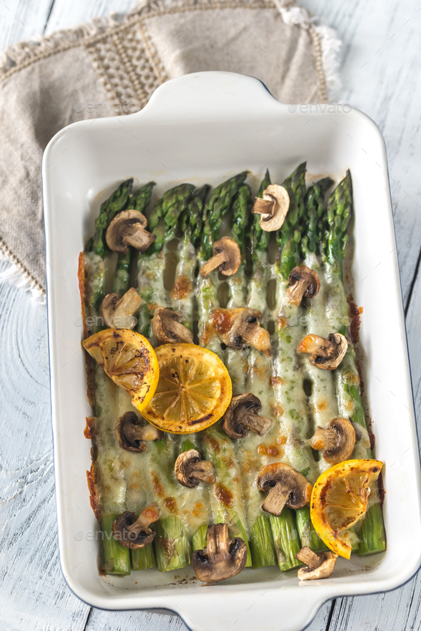Baked asparagus with mozzarella and lemon - Stock Photo - Images