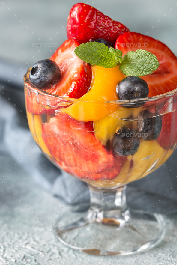 1Fruit salad in the glass vase - Stock Photo - Images