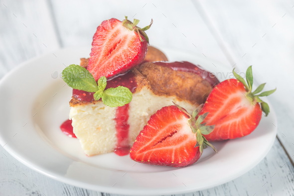 Slice of cheesecake with fresh strawberries - Stock Photo - Images