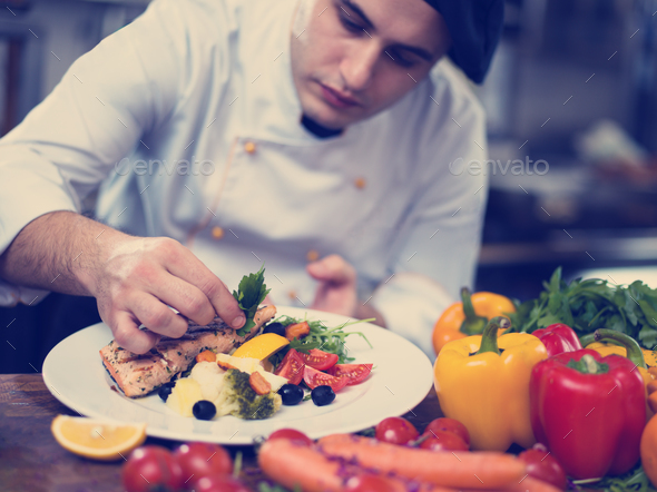 cook chef decorating garnishing prepared meal - Stock Photo - Images