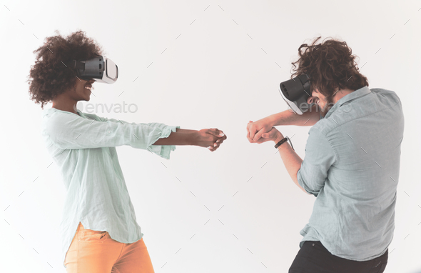 multiethnic couple getting experience using VR headset glasses - Stock Photo - Images