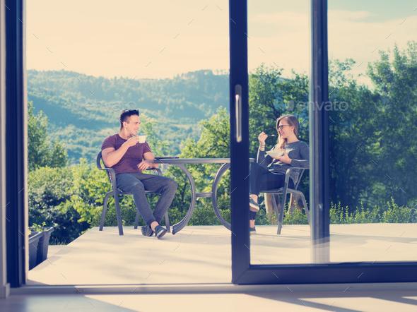 couple enjoying morning coffee and breakfast - Stock Photo - Images