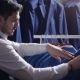 Man Choosing Business Suit at Men Clothing Store - VideoHive Item for Sale