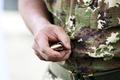 Soldier holding a loaded handgun magazine