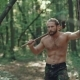 Portrait of Handsome Bearded Man with Ax in the Forest - VideoHive Item for Sale