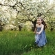 Little Girl Runs through a Flowering Garden - VideoHive Item for Sale