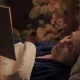 An Elderly Woman Is Lying in Bed under a Blanket and Reading a Book - VideoHive Item for Sale