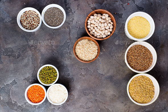Superfoods and cereals selection in bowls on stone background - Stock Photo - Images