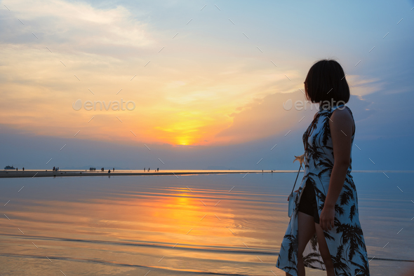 Woman watching Sunset at the beach - Stock Photo - Images