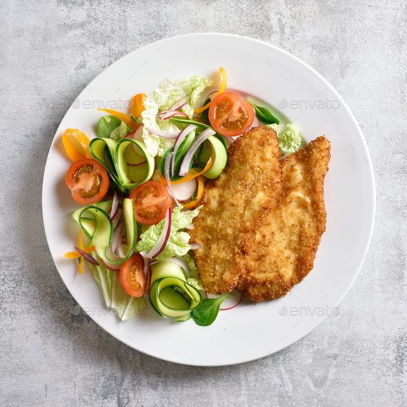 Vegetable salad and breaded chicken breast - Stock Photo - Images