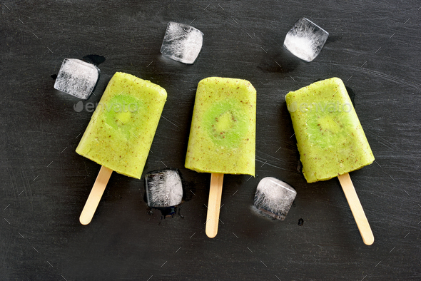 Popsicles from kiwi - Stock Photo - Images