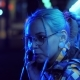 Attractive Pretty Girl with Unusual Hairstyle near Glowing Neon Lights of the City at Night Talking - VideoHive Item for Sale